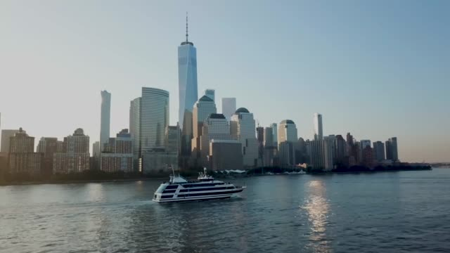 stockvideo's en b-roll-footage met drone nyc boat skyline sunrise - wall street lower manhattan