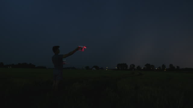 ws drone operator operating a drone to take off at night - pilot stock videos & royalty-free footage