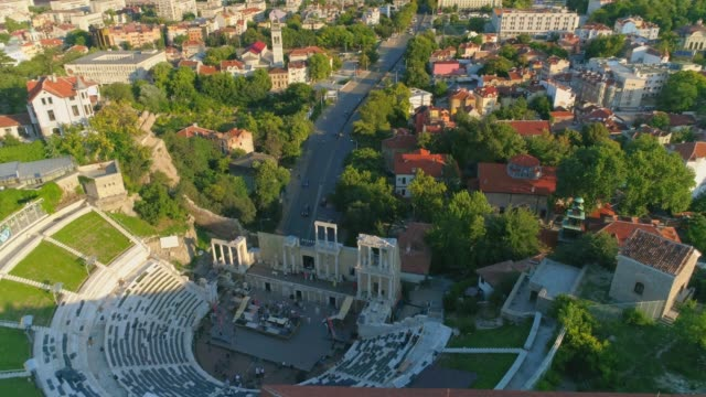 drone orbit tilt up revealing plovdiv city in bulgaria - bulgaria stock videos & royalty-free footage