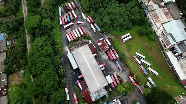 a drone orbits a bus depot lot in johor bahru malaysia - johor stock videos & royalty-free footage