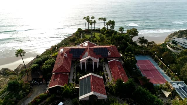 a drone orbits a cliffside mansion in san diego california - stately home stock videos & royalty-free footage