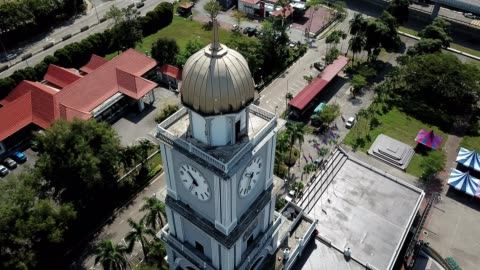 a drone orbits a clock tower in johor bahru malaysia - clock tower stock videos & royalty-free footage