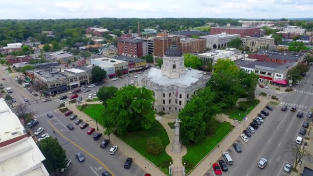 a drone orbits a courthouse in bloomington indiana - indiana stock videos & royalty-free footage