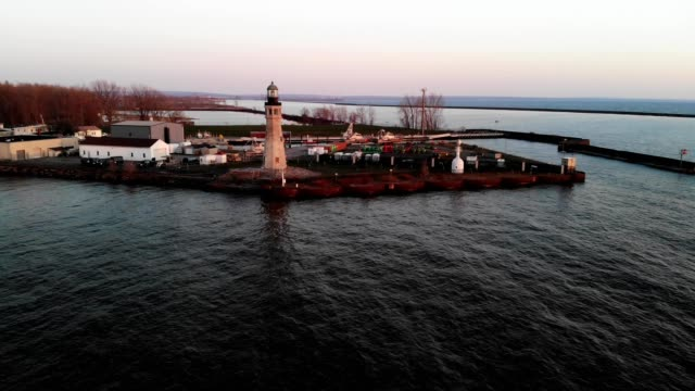 A drone orbits a lighthouse near the Erie Basin Marina in Buffalo New York