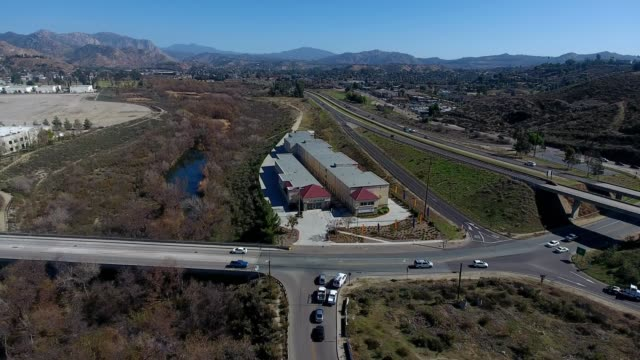 a drone orbits a self storage facility in lakeside california - self storage stock videos and b-roll footage