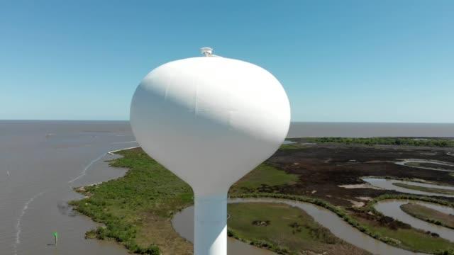 a drone orbits a water tower on the gulf of mexico in bay saint louis mississippi - saint louis bildbanksvideor och videomaterial från bakom kulisserna