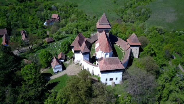 A drone orbits the fortified church of Viscri in Județul Brașov Romania