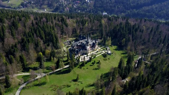 A drone orbits the Peles Castle in Sinaia Prahova Romania