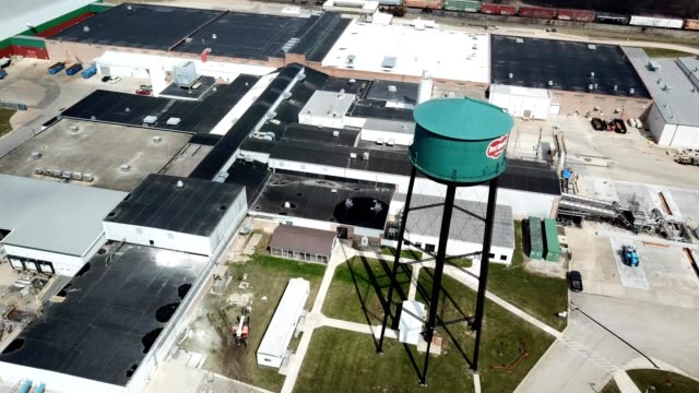 a drone orbits the water tower of mendota illinois - dronebase stock videos and b-roll footage