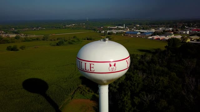 a drone orbits the water tower of yorkville illinois - yorkville illinois stock videos & royalty-free footage