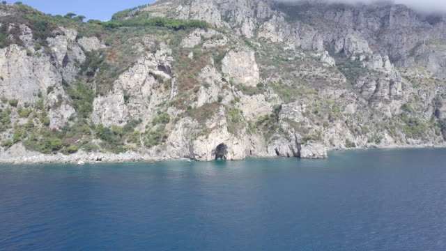drone over a cave in amalfi coast. beautiful coastline, cliffs and maquis shrubland - shrubland stock videos & royalty-free footage