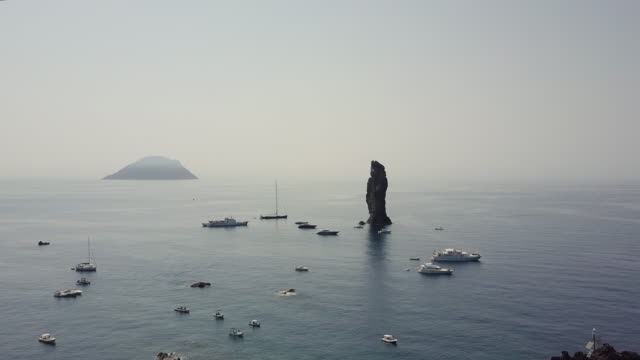 Drone over a sea stack in the Aeolian Islands, Sicily, Italy