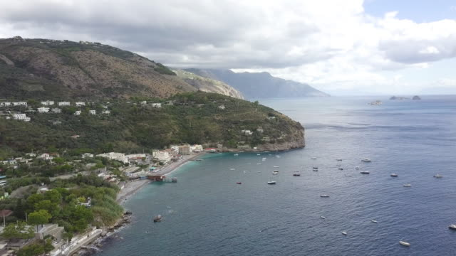 drone over amalfi coast and a harbor. beautiful coastline, cliffs and maquis shrubland 3 - shrubland stock videos & royalty-free footage