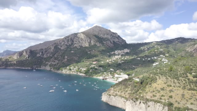 drone over amalfi coast and a harbor. beautiful coastline, cliffs and maquis shrubland 8 - shrubland stock videos & royalty-free footage