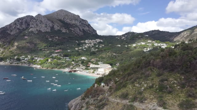 Drone over Amalfi Coast and a harbor. Beautiful coastline, cliffs and maquis shrubland 11