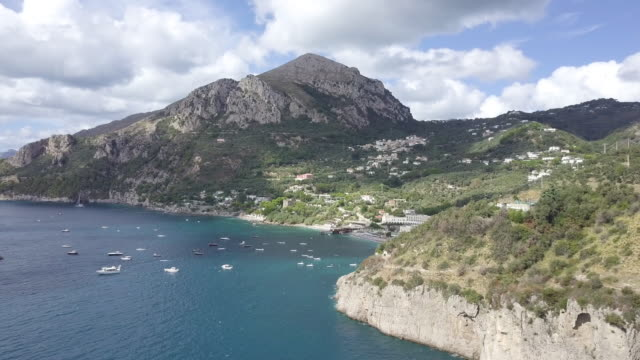 drone over amalfi coast and a harbor. beautiful coastline, cliffs and maquis shrubland 10 - shrubland stock videos & royalty-free footage
