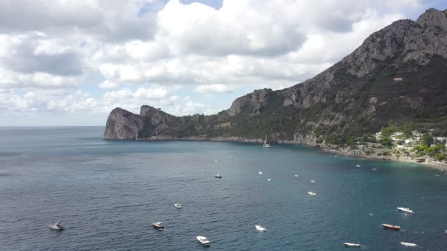 drone over amalfi coast and a harbor. beautiful coastline, cliffs and maquis shrubland 12 - shrubland stock videos & royalty-free footage
