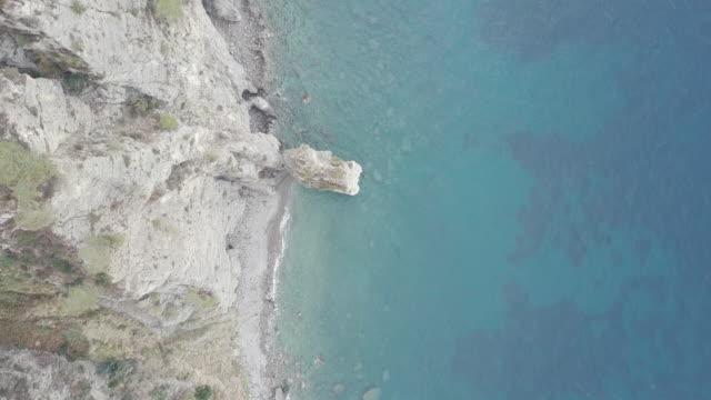 Drone over Amalfi Coast. Beautiful coastline, cliffs, green trees and Mediterranean sea