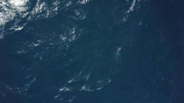 drone over amalfi coast sea, italy - wasseroberfläche stock-videos und b-roll-filmmaterial