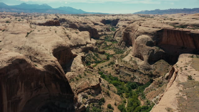 drone over canyon at moab, utah - natural arch stock videos & royalty-free footage
