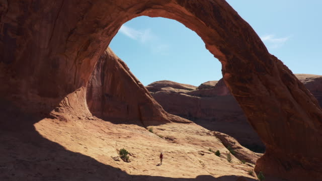 drone over corona and bow tie arch, moab, utah - arch stock videos & royalty-free footage