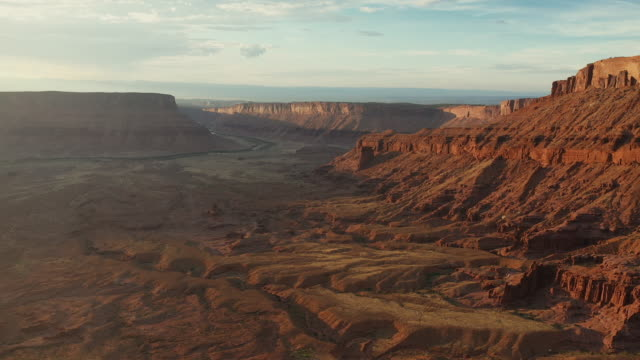 drone over desert and canyons near moab, utah - natural arch stock videos & royalty-free footage