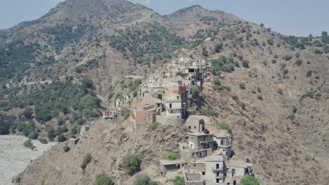 drone over ghost town of roghudi vecchia, calabria, italy 15 - abbandonato video stock e b–roll