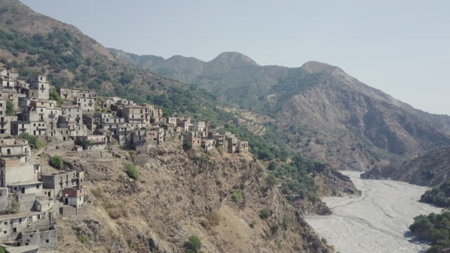 drone over ghost town of roghudi vecchia, calabria, italy 2 - abbandonato video stock e b–roll