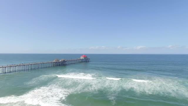 drone over huntington beach - huntington beach california stock videos and b-roll footage