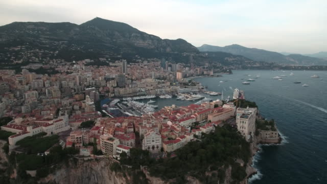 drone, over monaco city harbor and bay. - monaco stock-videos und b-roll-filmmaterial