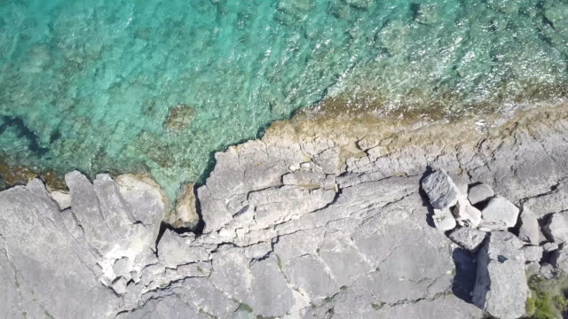 drone over paxi island coastline and cliffs, greece - greek islands stock videos and b-roll footage