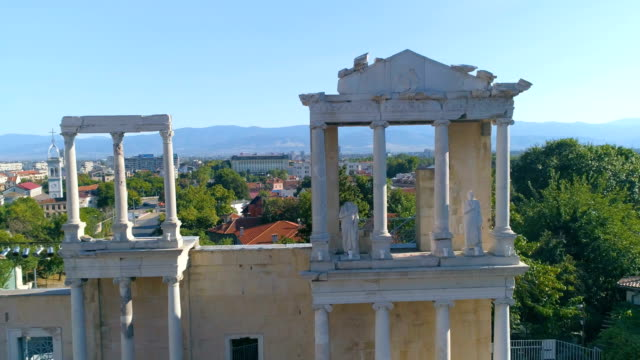 Drone panning shot of the columns of an ancient roman amphitheater in the old town of Plovdiv, Bulgaria