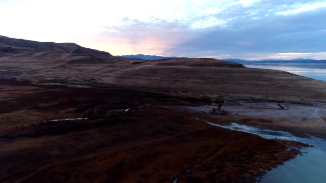 a drone pans a beach harbor during sunset in provo utah - provo stock videos & royalty-free footage