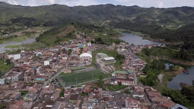 A drone pans around the town of El Peñol Antioquia