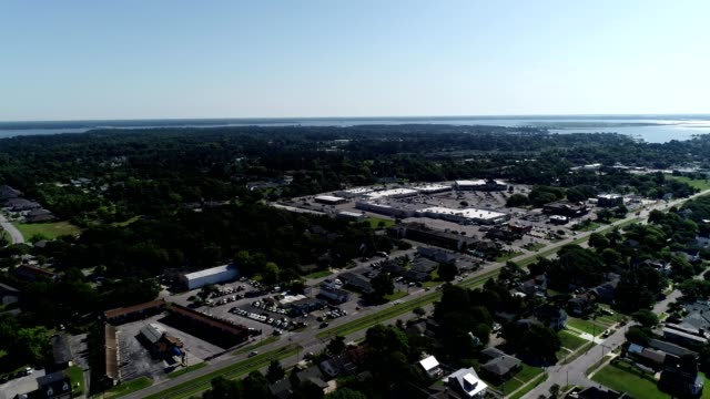 a drone pans over a highway in the city of atlantic beach north carolina - atlantic beach north carolina stock videos & royalty-free footage