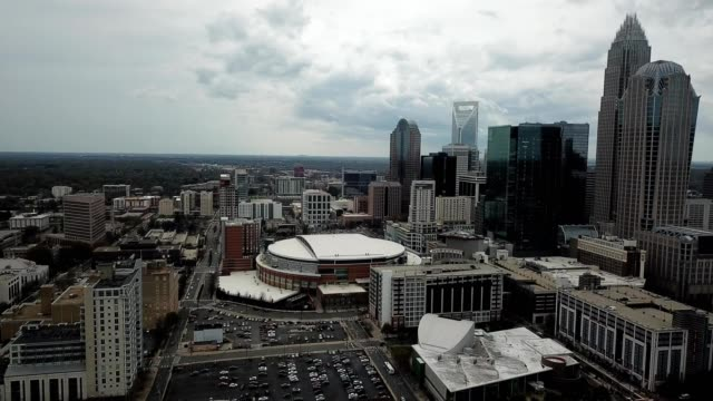 a drone pans over downtown charlotte north carolina - charlotte north carolina stock videos & royalty-free footage