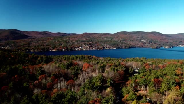 a drone pans over lake george in new york - autumn leaf color stock videos & royalty-free footage