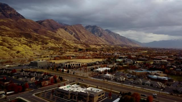 a drone pans over provo utah during sunset - provo stock videos & royalty-free footage