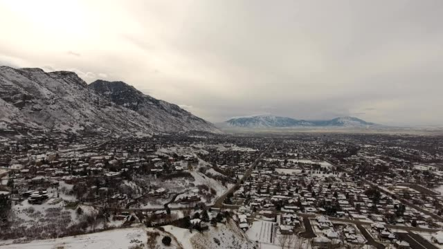 a drone pans over snow covered provo utah - provo stock videos and b-roll footage