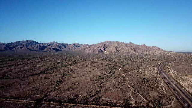 a drone pans over the white tank mountains in surprise arizona - dronebase stock videos and b-roll footage