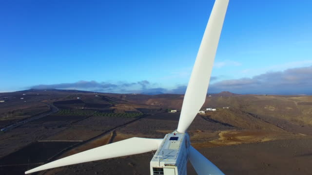 drone pan-up of a wind turbine - moving up stock videos & royalty-free footage