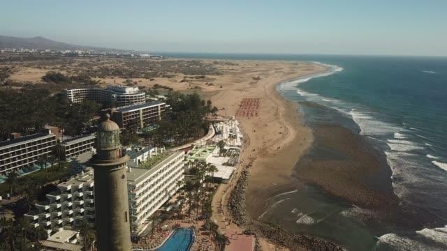 drone perspective of faro de maspalomas, maspalomas, gran canaria, spain. - grand canary stock videos and b-roll footage