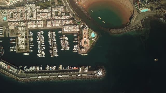 drone perspective of puerto de mogan, gran canaria, spain. - grand canary stock videos & royalty-free footage