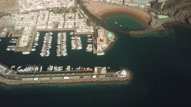 drone perspective of puerto de mogan, gran canaria, spain. - grand canary stock videos and b-roll footage