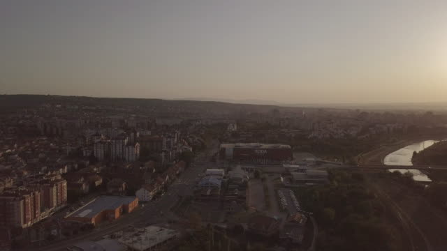 drone point of view city of nis in dusk - serbia stock videos & royalty-free footage