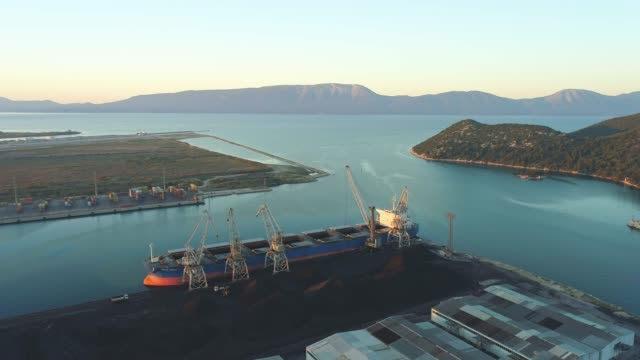 WS Drone point of view cranes,buildings and container ship at industrial marina,Croatia