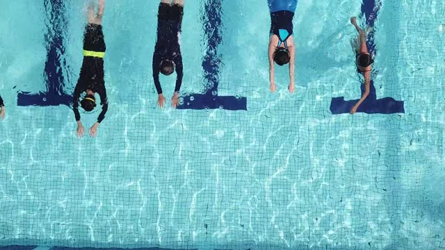 drone point of view directly above swimming pool coach instructor teaching her student swimming skill - instructor stock videos & royalty-free footage