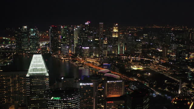 drone point of view of downtown singapore at night time - tall high stock videos & royalty-free footage