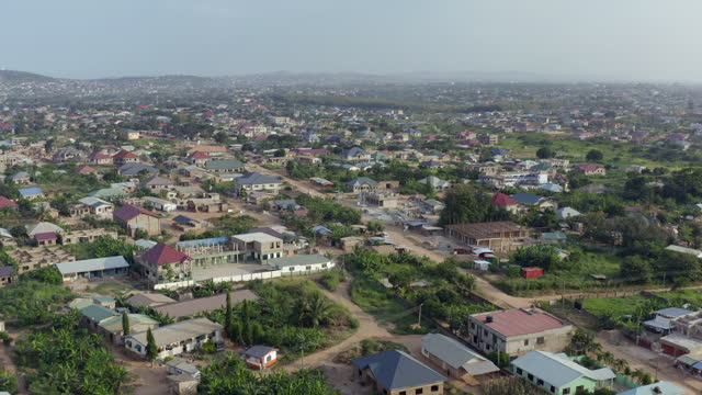drone point of view on a town in ghana - ghana stock videos & royalty-free footage