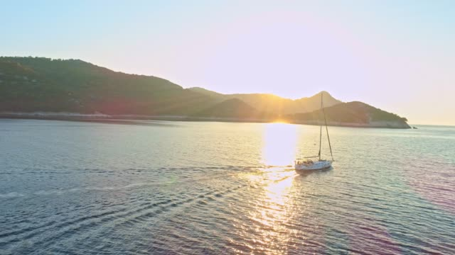 4k drone point of view sailboat on sunny tranquil ocean, real time - sailing boat stock videos and b-roll footage